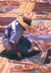 image of Genna Panzarella re-creating a section of Michelangelo's Sistine Chapel ceiling in 2003; photo by Dean Lipoff