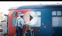 bob painting railcar at county school on the mid norfolk